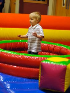 Toddler playing on an inflatable goat events